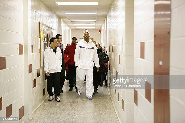 Kobe Bryant of the Los Angeles Lakers walks the hallways while visiting his alma mater Lower Merion High School March 9 2007 in Philadelphia...