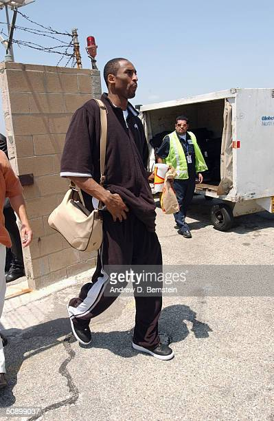 Kobe Bryant of the Los Angeles Lakers walks to the plane before Game one of the Western Conference Finals during the 2004 NBA Playoffs on May 21 2004...
