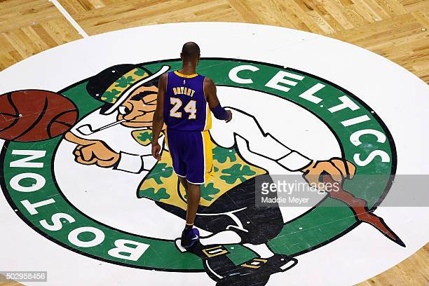 Kobe Bryant of the Los Angeles Lakers walks towards the bench during a time out against the Boston Celtics during the fourth quarter at TD Garden on...