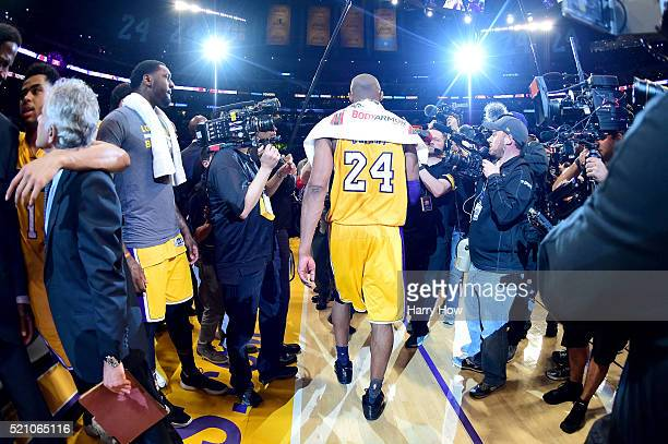 Kobe Bryant of the Los Angeles Lakers walks towards the tunnel after scoring 60 points against the Utah Jazz at Staples Center on April 13, 2016 in...