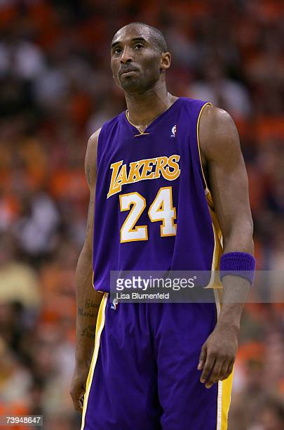 Kobe Bryant of the Los Angeles Lakers walks upcourt in the final minutes against the Phoenix Suns in Game One of the Western Conference Quarterfinals...