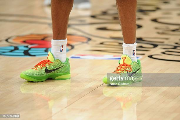 Kobe Bryant of the Los Angeles Lakers warms up wearing green Nike Zoom Kobe VI shoes before taking on the Miami Heat at Staples Center on December 25...