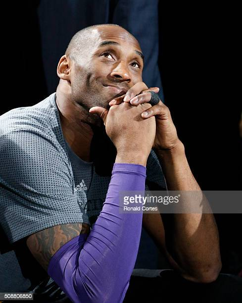 Kobe Bryant of the Los Angeles Lakers watches tribute at ATT Center on February 6 2016 in San Antonio Texas NOTE TO USER User expressly acknowledges...