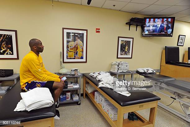 Kobe Bryant of the Los Angeles Lakers watches TV before the game against the New Orleans Pelicans at STAPLES Center on January 12 2016 in Los Angeles...