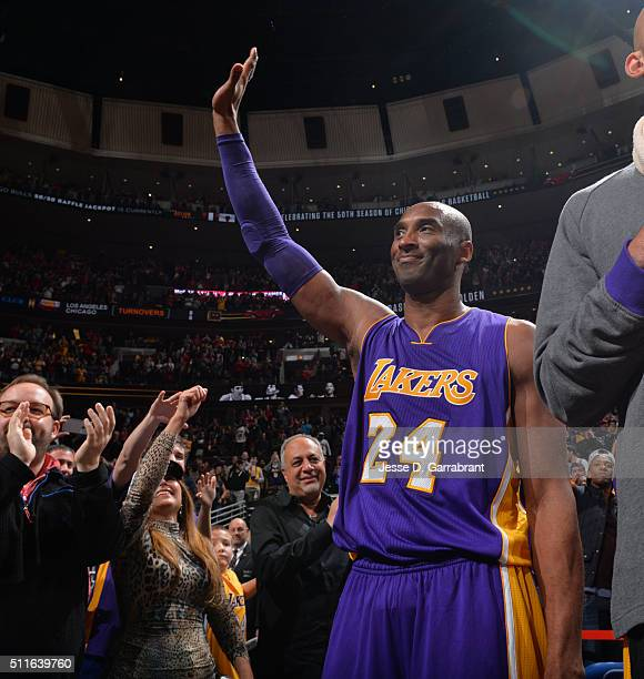 Kobe Bryant of the Los Angeles Lakers waves from the bench against the Chicago Bulls on February 21 2016 at the United Center in Chicago Illinois...