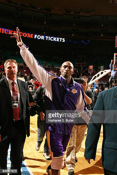 Kobe Bryant of the Los Angeles Lakers waves to fans after breaking the Madison Square Garden record of highest scoring points in a game with 61...