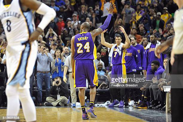 Kobe Bryant of the Los Angeles Lakers waves to fans in the final moments of a game against the Memphis Grizzlies at FedExForum on February 24 2016 in...