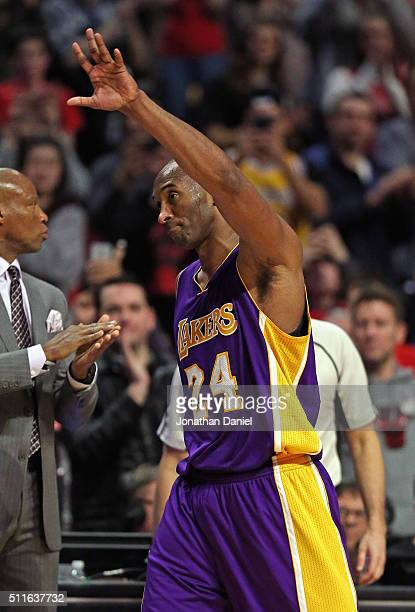 Kobe Bryant of the Los Angeles Lakers waves to the crowd after he is taken of of a game against the Chicago Bulls in the 4th quarter at the United...