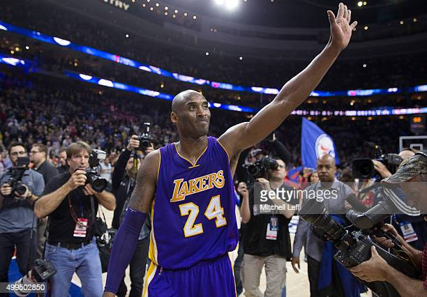 Kobe Bryant of the Los Angeles Lakers waves to the crowd after the game against the Philadelphia 76ers on December 1 2015 at the Wells Fargo Center...