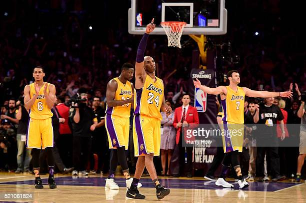 Kobe Bryant of the Los Angeles Lakers waves to the crowd as he is taken out of the game after scoring 60 points against the Utah Jazz at Staples...