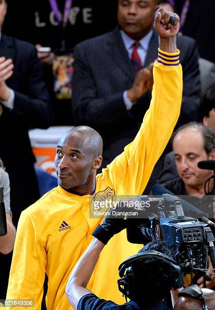 Kobe Bryant of the Los Angeles Lakers waves to the crowd as he walks on the court before the game against the Utah Jazz on April 13 2016 at Staples...