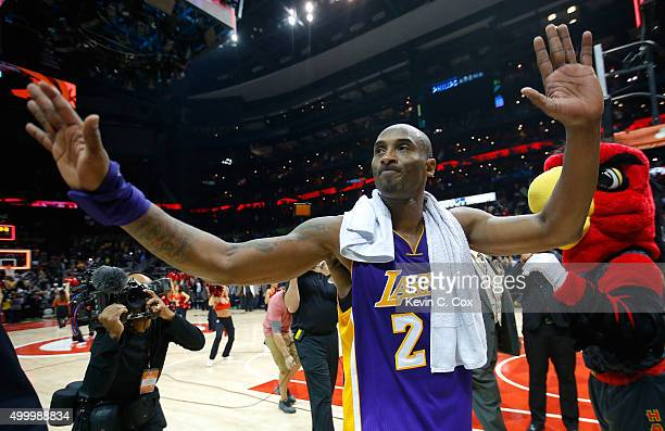 Kobe Bryant of the Los Angeles Lakers waves to the fans after their 100-87 loss to the Atlanta Hawks at Philips Arena on December 4, 2015 in Atlanta,...