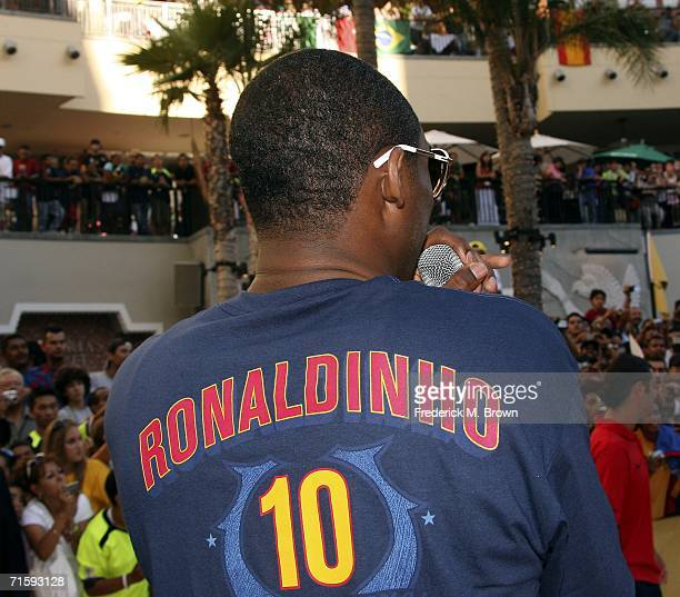 Kobe Bryant of the Los Angeles Lakers wears a jersey of Ronaldinho of Brazil at Nike European Club Champion FC Barcelona Rally at Hollywood and...