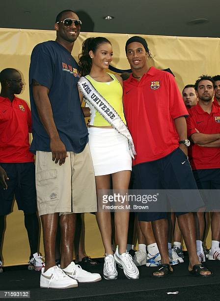 Kobe Bryant of the Los Angeles Lakers Zuleyka Rivera Miss Universe and Ronaldinho of Brazil speak at Nike European Club Champion FC Barcelona Rally...