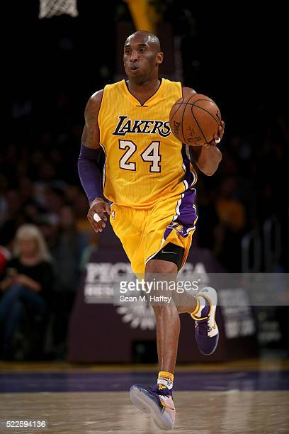 Kobe Bryant of the the Los Angeles Lakers dribbles upcourt during a basketball game against the Los Angeles Clippers at Staples Center on April 6...
