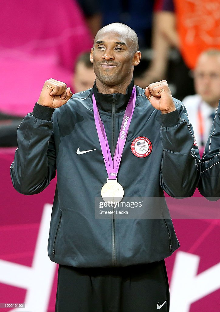 Kobe Bryant #10 of the United States celebrates on the podium during the medal ceremony for the Men's Basketball gold medal game between the United States and Spain on Day 16 of the London 2012 Olympics Games at North Greenwich Arena on August 12, 2012 in London, England.
