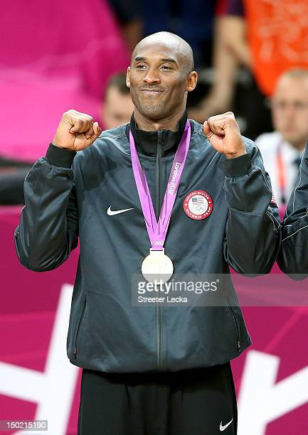 Kobe Bryant of the United States celebrates on the podium during the medal ceremony for the Men's Basketball gold medal game between the United...