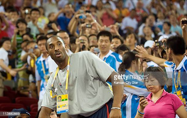 Kobe Bryant of the United States' men's basketball team watches as the USA women face the Czech Republic in the opening round of basketball on...
