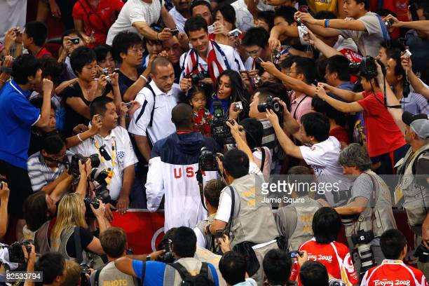 Kobe Bryant of the United States moves through the media to reach his wife Vanessa and daughter Gianna after defeating Spain 118107 in the gold medal...