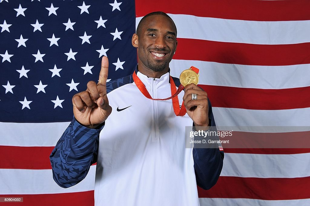 Kobe Bryant #10 of the United States poses with his gold medal after winning the men's gold medal at the 2008 Beijing Olympic Games against Spain at the Beijing Olympic Basketball Gymnasium on August 24, 2008 in Beijing, China. The United States defeated Spain 118-107 to take the men's gold medal.