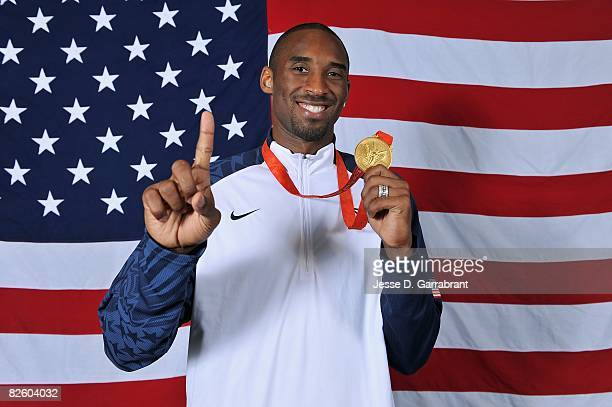 Kobe Bryant of the United States poses with his gold medal after winning the men's gold medal at the 2008 Beijing Olympic Games against Spain at the...