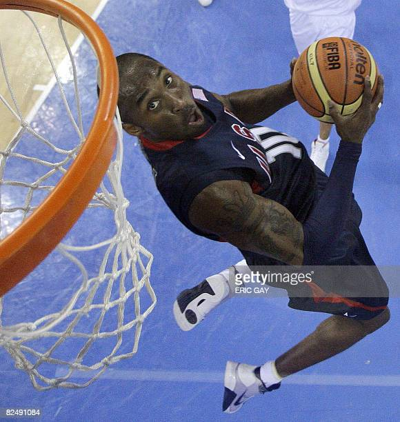 Kobe Bryant of the US goes up for a dunk against Spain in their men's preliminary basketball game against China at the 2008 Beijing Olympic Games on...