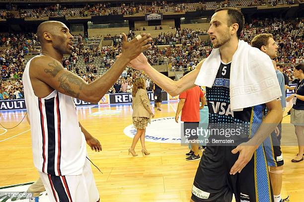 Kobe Bryant of the US Men's Senior National Team and Emanuel Ginobili of the Argentinean Men's Senior National Team shake hands after a game at Palau...