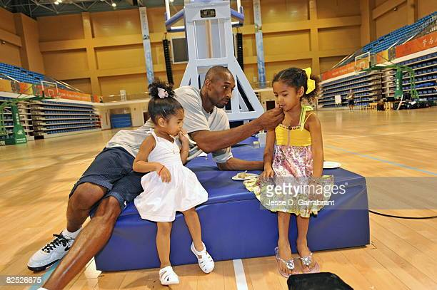 Kobe Bryant of the US Men's Senior National Team celebrates his birthday with his daughters Nyla and Natalia during practice at the 2008 Beijing...