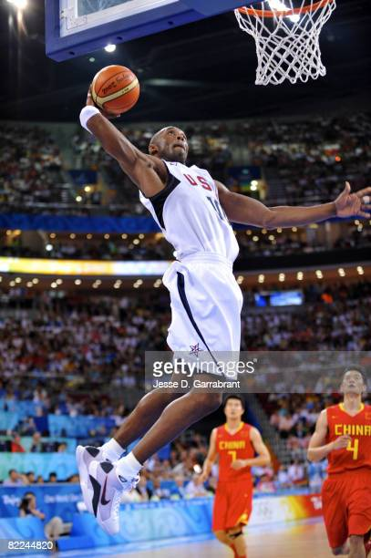 Kobe Bryant of the US Men's Senior National Team dunks against China during day 2 of the men's preliminary basketball game at the 2008 Beijing...