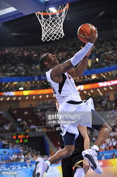 Kobe Bryant of the U.S. Men's Senior National Team dunks against Germany during the men's group B basketball preliminaries at the 2008 Beijing...