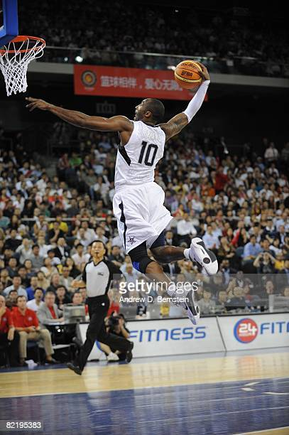 Kobe Bryant of the US Men's Senior National Team dunks against Lithuania on August 1 2008 at the Cotai Arena in Macao China The US Men's National...