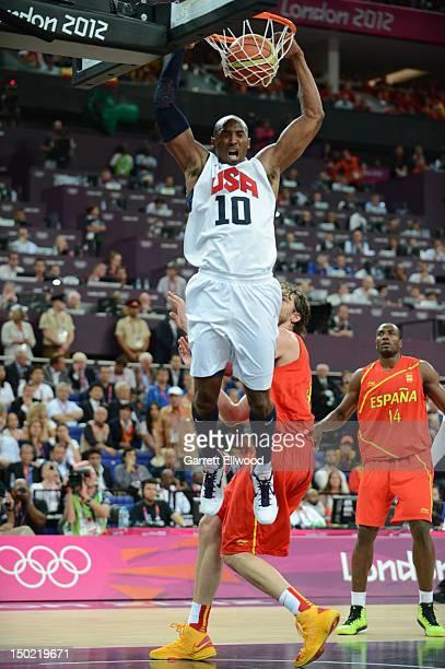 Kobe Bryant of the US Men's Senior National Team dunks against Pau Gasol of Spain during their Men's Gold Medal Basketball Game on Day 16 of the...