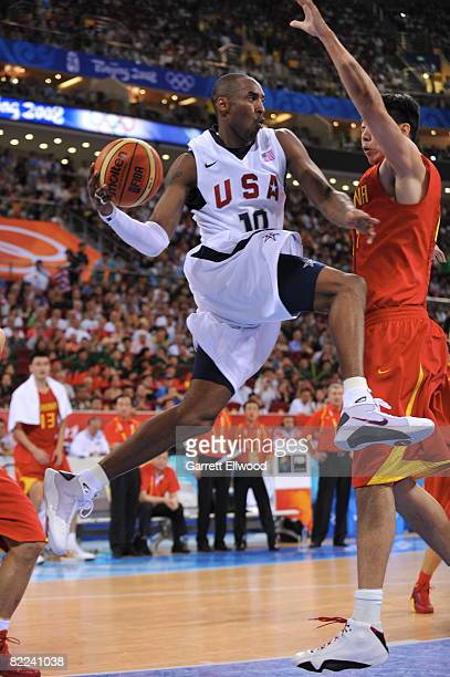 Kobe Bryant of the US Men's Senior National Team looks to pass against Wang Zhizhi of China during day 2 of the men's preliminary basketball game at...