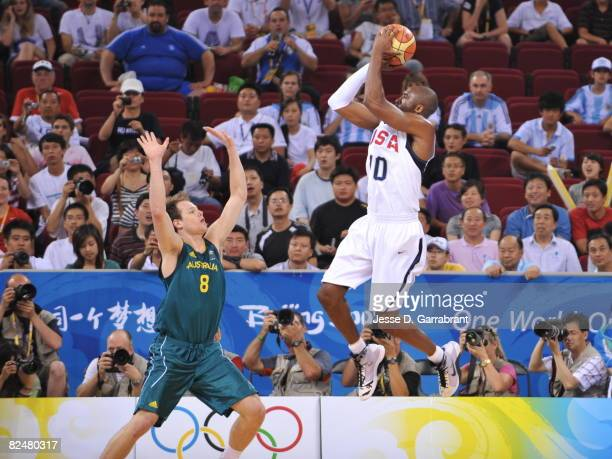Kobe Bryant of the US Men's Senior National Team shoots against Brad Newley of Australia during the men's quarterfinals basketball game at the 2008...
