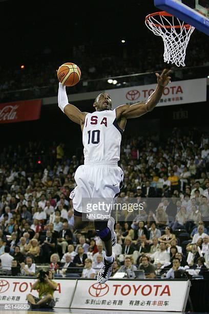 Kobe Bryant of the USA Basketball Men's Senior National Team dunks against the Lithuania National Team during the USA Basketball International...