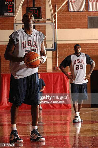 Kobe Bryant of the USA Basketball Men's Senior National Team shoots a free throw as LeBron James looks on during training camp at Valley High School...