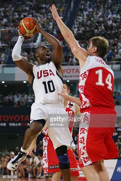 Kobe Bryant of the USA Basketball Men's Senior National Team shoots on against Aleksey Savrasenko of the Russian National Team during the USA...