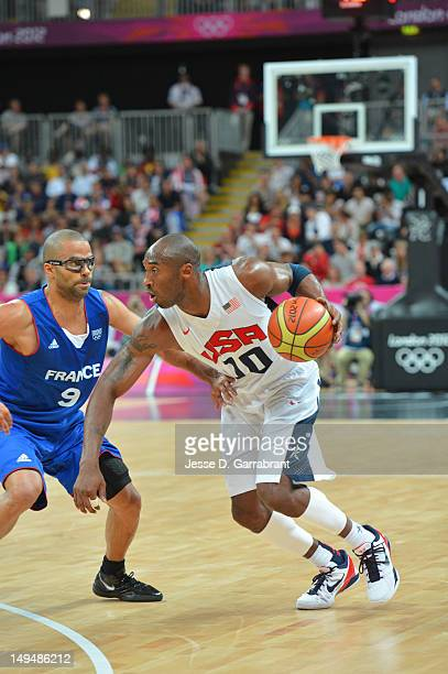 Kobe Bryant of the USA Mens Senior National team drives against Tony Parker of France at the Olympic Park Basketball Arena during the London Olympic...