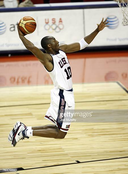 Kobe Bryant of the USA Men's Senior National Team elevates for a dunk against Canada during the first round of the 2007 FIBA Americas Championship on...