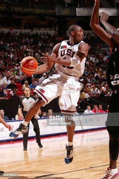 Kobe Bryant of the USA Men's Senior National Team looks to pass against Canada during the first round of the 2007 FIBA Americas Championship at the...