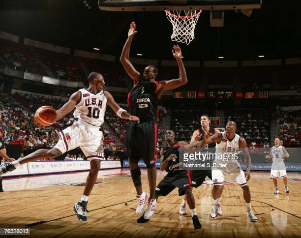 Kobe Bryant of the USA Men's Senior National Team passes against Samuel Dalembert of Canada during the first round of the 2007 FIBA Americas...