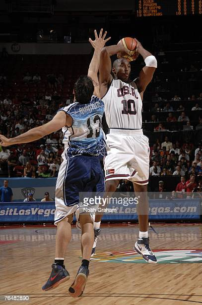 Kobe Bryant of the USA Men's Senior National Team passes against Carlos Delfino of Argentina during the gold medal game of the 2007 FIBA Americas...