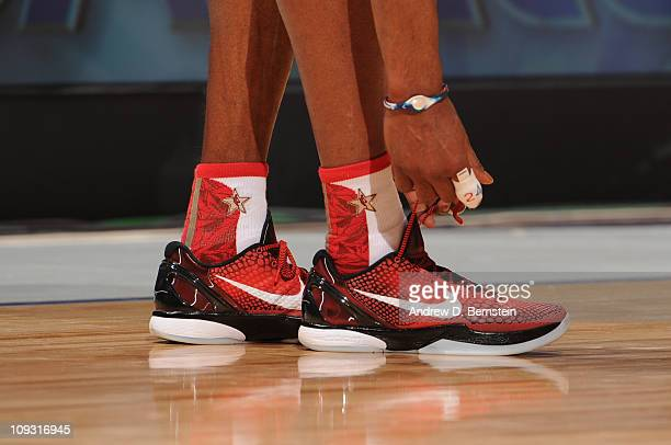 Kobe Bryant of the Wesern Conference AllStars ties his shoe during a game against the Eastern Conference AllStars in the 2011 NBA AllStar Game at...