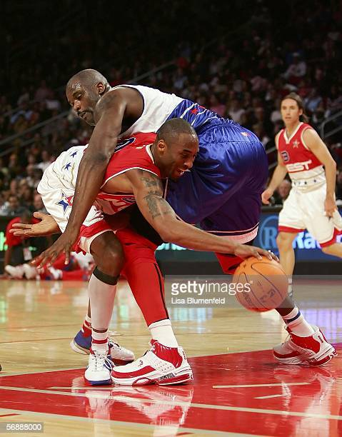 Kobe Bryant of the West Team is grabbed by Shaquille O'Neal of the East Team and fouled at the 2006 NBA AllStar Game during NBA AllStar Weekend at...
