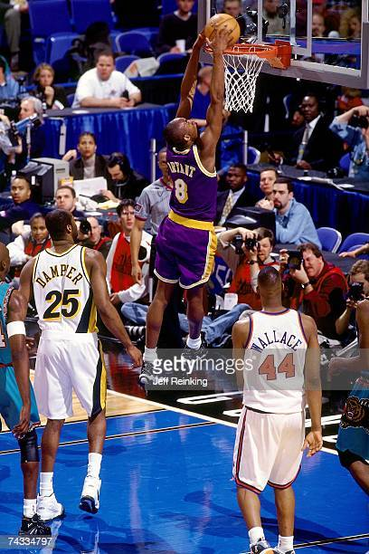 Kobe Bryant of the Wester Conference attempts a dunk against John Wallace of the Eastern Conference during the 1997 Rookie AllStar game played...