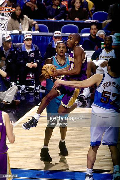 Kobe Bryant of the Wester Conference attempts a layup against the Eastern Conference during the 1997 Rookie AllStar game played February 8 1997 at...
