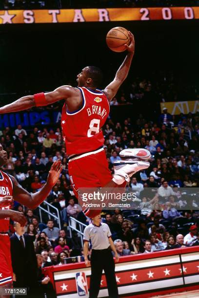 Kobe Bryant of the Western Conference All Stars soars up for a slam dunk against the Eastern Conference All Stars during the 2003 NBA AllStar Game at...