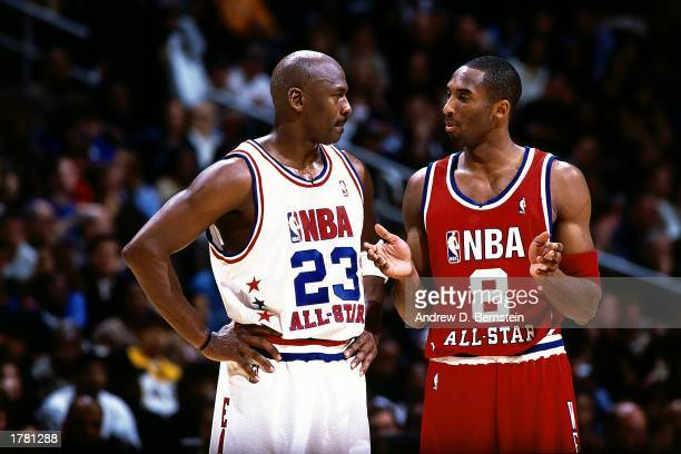 Kobe Bryant of the Western Conference All Stars talks with Michael Jordan of the Eastern conference All Stars during the 2003 NBA All-Star Game at...