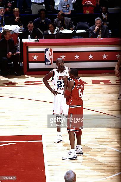Kobe Bryant of the Western Conference AllStars and Michael Jordan of the Eastern Conference take a moment to talk during the 52nd NBA AllStar Game at...