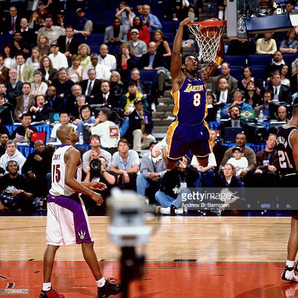 Kobe Bryant of the Western Conference AllStars attempts a dunk against Vince Carter of the Eastern Conference AllStars during the 2000 NBA AllStar...